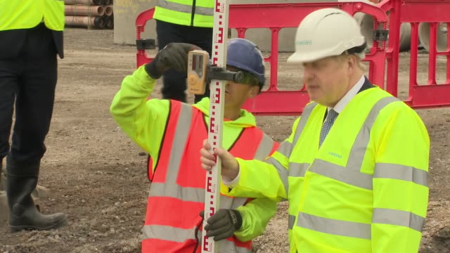 boris johnson visiting a construction site - measuring stock videos & royalty-free footage