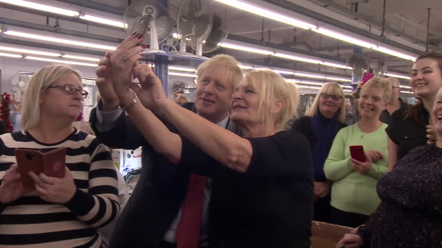 boris johnson visiting a textile factory in derbyshire - photography themes stock videos & royalty-free footage