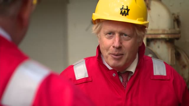 boris johnson visiting devon shipyard; england: devon: appledore: int various of boris johnson mp touring shipyard and meeting and chatting with... - visit stock videos & royalty-free footage