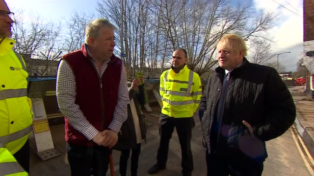 boris johnson visiting residents in bewdley after it was hit by heavy flooding - civilian stock videos & royalty-free footage