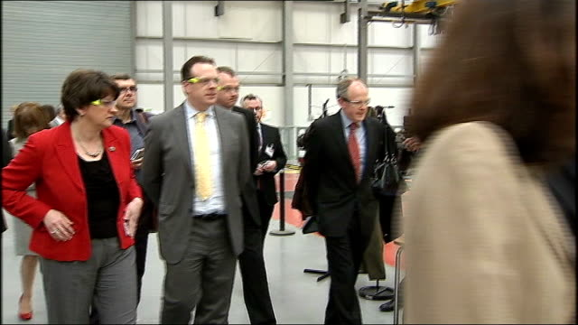 stockvideo's en b-roll-footage met boris johnson visits bus facility in ballymena; northern ireland: ballymena: wrightbus: ext boris johnson chatting at entrance with theresa villiers... - chassis
