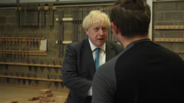 boris johnson visits devon and exeter construction training centre; england: devon: exeter college: devon and exeter construction training centre:... - blowing stock videos & royalty-free footage