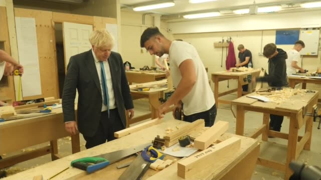 boris johnson visits devon and exeter construction training centre; england: devon: exeter college: devon and exeter construction training centre:... - tapping stock videos & royalty-free footage