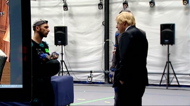 Boris Johnson visits Ealing Studios Further shots of Boris Johnson operating camera/ Boris Johnson chatting with avatar 'actors' in studio/ Boris...