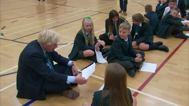 boris johnson visits leicestershire school; england: leicestershire: coalville: castle rock high school: int boris johnson mp sitting on floor of... - visit stock videos & royalty-free footage
