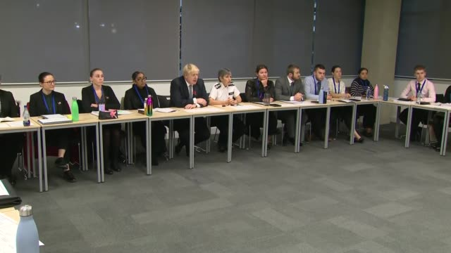 boris johnson visits metropolitan police training centre england london hendon int various of boris johnson mp commissioner cressida dick and others... - round table discussion stock videos & royalty-free footage