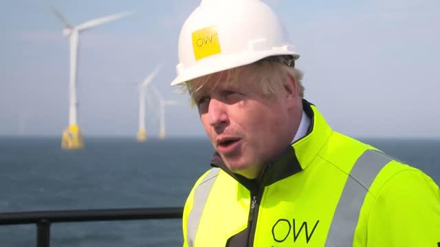 boris johnson visits offshore wind farm / interview; scotland: off aberdeenshire coast: moray east offshore wind farm: ext boris johnson mp interview... - bonding stock videos & royalty-free footage
