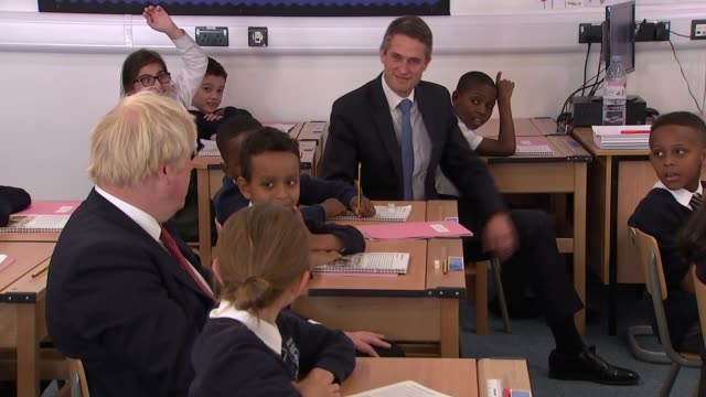 boris johnson visits pimlico primary school; england: london: pimlico: pimlico primary school: gvs drawings on wall / boris johnson and gavin... - william the conqueror stock videos & royalty-free footage
