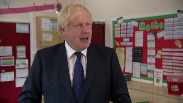 stockvideo's en b-roll-footage met boris johnson visits school in east london; england: east london: st joseph's school: int boris johnson mp interview sot. - migration - is it... - dawn french