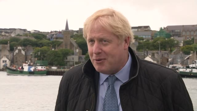 boris johnson visits scotland: boris johnson interview; scotland: orkney: ext boris johnson mp interview sot - i'm thrilled to be here in orkney... - fuel and power generation stock-videos und b-roll-filmmaterial