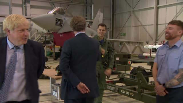 boris johnson visits scotland: boris johnson visit raf lossiemouth; scotland: moray: lossiemouth: raf lossiemouth: int gvs inside aircraft hangar /... - airplane hangar stock videos & royalty-free footage
