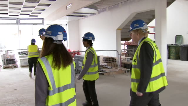boris johnson visits secondary school in ealing that is being built as he announces plans to increase government funding into rebuilding school... - rebuilding stock videos & royalty-free footage