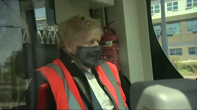 boris johnson visits west midlands depot; england: west midlands: near birmingham: wednesbury: int boris johnson mp and others along through... - politics stock-videos und b-roll-filmmaterial