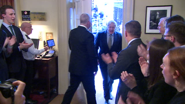 boris johnson walking into 10 downing street to cheers and applause, after winning a large majority in the general election - winning stock videos & royalty-free footage