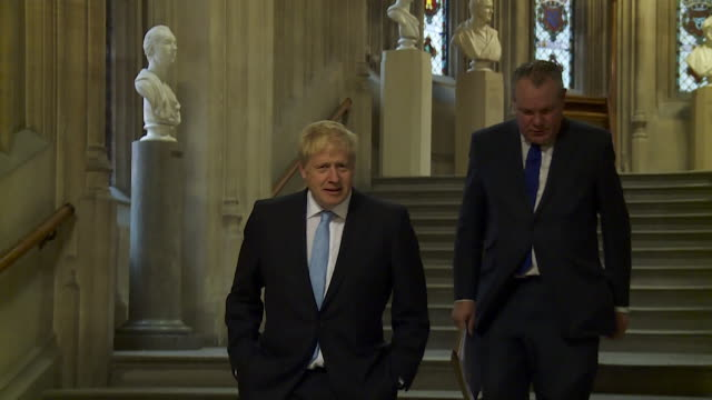 boris johnson walks down steps in houses of parliament after being voted into the final two of the conservative leadership election - walking stock videos & royalty-free footage