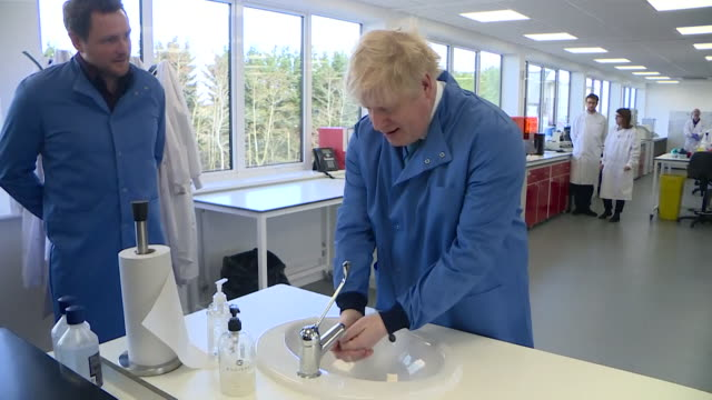 boris johnson washes hands due to coronavirus outbreak on visit to laboratory in thurleigh - press conference stock videos & royalty-free footage