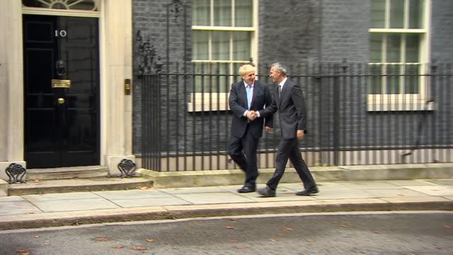 boris johnson welcoming nato secretary general jens stoltenberg to 10 downing street - 10 downing street stock videos & royalty-free footage