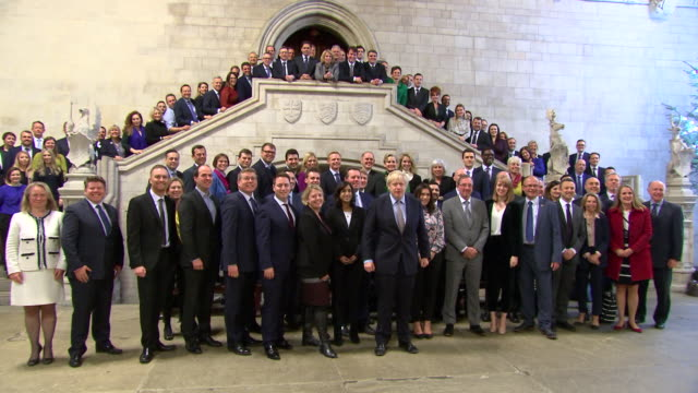 boris johnson welcoming new conservative mp's to parliament after a landslide general election victory - elezioni generali video stock e b–roll