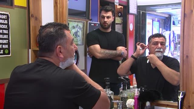 boris johnson's barber england london clerkenwell the bay room barbershop int cevdet isik shaving himself in mirror using straight razor/ other man... - shaving brush stock videos & royalty-free footage