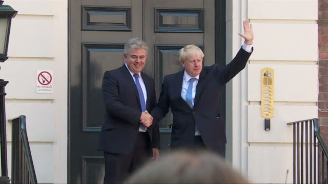 boris johnson's motorcade arriving at and leaving from the conservative party headquarters after being announced as the new leader and prime minister - new stock videos & royalty-free footage