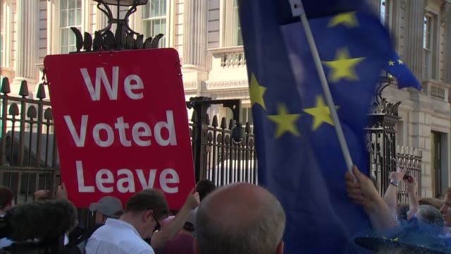 boris johnson's motorcade arriving at downing street / protesters gathered; england: london: westminster: whitehall: ext various shots of pro-brexit... - 2016 european union referendum stock videos & royalty-free footage