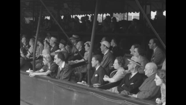 boris karloff deems taylor franklin p adams john kieran chair umpire clifton fadiman stand at net with their rackets / high angle view of the crowd... - tennis racket stock videos & royalty-free footage