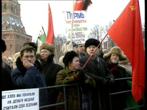 Boris Yeltsin calls for more time for reforms RUSSIAN Moscow MS Communist demos with red flags chanting behind barriers CMS Old woman as chanting LMS...