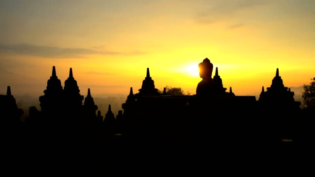 borobudur at sunrise temple and tourism wonder indonesia - old ruin stock videos & royalty-free footage