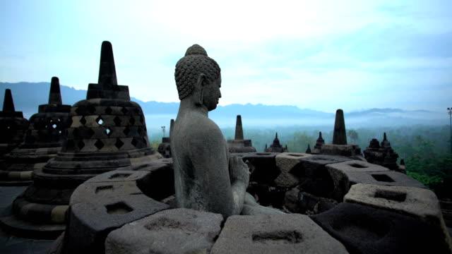 borobudur at sunrise temple to buddhism java indonesia - buddha video stock e b–roll