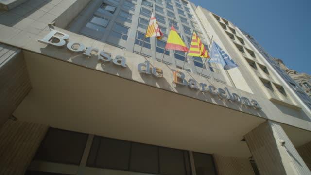 borsa de barcelona stock market building dolly shot. bolsa de barcelona - boulevard stock videos & royalty-free footage