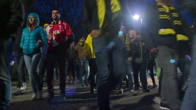 borussia dortmund fans leaving their rearranged champions league match against monaco after the original match was postponed due to a bombing attack... - borussia dortmund stock videos and b-roll footage