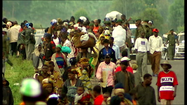 bosco ntaganda pleads not guilty to war crimes and crimes against humanity t02041243 / tx various shots displaced people carrying their belongings... - ボスコ・ンタガンダ点の映像素材/bロール
