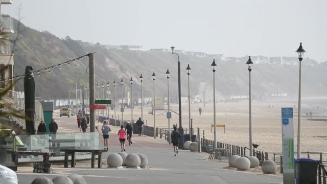 boscombe beach in dorset stands relatively empty as members of the public heed the government's plea for maintained social distancing despite the... - bournemouth england stock videos & royalty-free footage