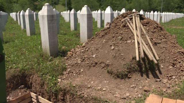 bosnia commemorates saturday the 20th anniversary of the massacre of some 8000 muslim men and boys in the unprotected enclave of srebrenica - srebrenica stock videos and b-roll footage