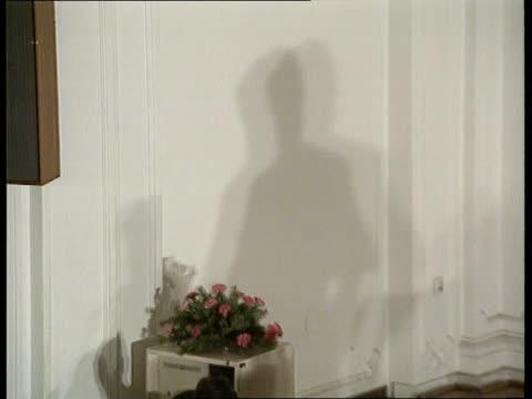 bosnia herzegovina declares independence: koljevic interview; itn banja luca: tms shadow on wall of man speaking at microphone pull back to leader of... - radovan karadzic stock videos & royalty-free footage