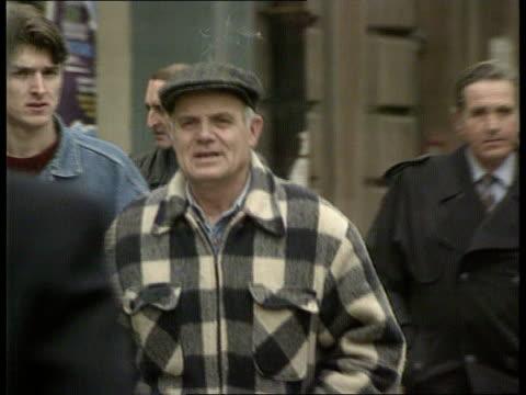 koljevic interview itn yugoslavia bosnia herzegovina sarajevo three men in street chatting smiling ms people to and fro in street shaking ms groups... - sarajevo stock-videos und b-roll-filmmaterial