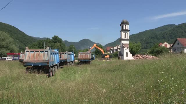 bosnia on saturday started to demolish an unauthorized church built by serbs at the garden of a muslim bosnian woman. fata orlovic, 77-year-old... - 2010 2019 stock videos & royalty-free footage