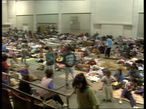 bosnia refugees flee / un peacekeepers withdraw 2145 tuzla cms infant in refugee centre ms young boys seated on floor in refugee centre cms young... - bosnia and hercegovina stock videos & royalty-free footage