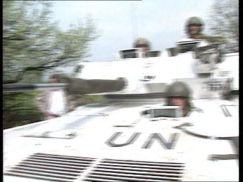 peace plan reaction; int vehicle bv track forward behind un armoured vehicle ext un soldiers in apc r-l serbians standing by side of road cms some... - toy gun stock videos & royalty-free footage