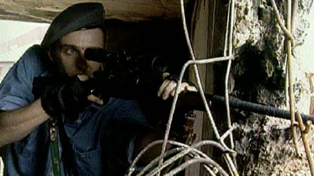 bosnian serb wartime general ratko mladic arrested; tx 26.7.1992 shots of serbian sniper firing rifle - ratko mladic stock videos & royalty-free footage