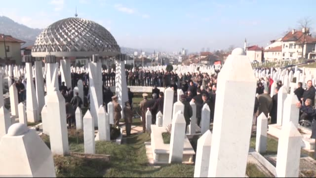 Bosnians attend a ceremony at Martyrs' memorial cemetery Kovaci marking the 23rd anniversary of Bosnia and Herzegovina's independence on March 01...