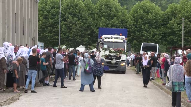 bosnians mourn for their relatives as the bodies of recently identified remains of 33 victims of srebrenica genocide are being transported to battery... - srebrenica stock videos and b-roll footage