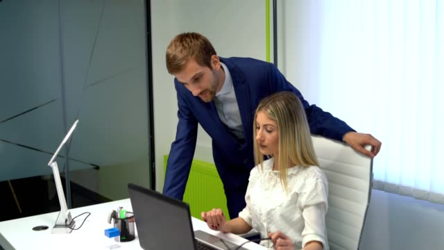 boss and attractive young blond employee - employee stock videos & royalty-free footage