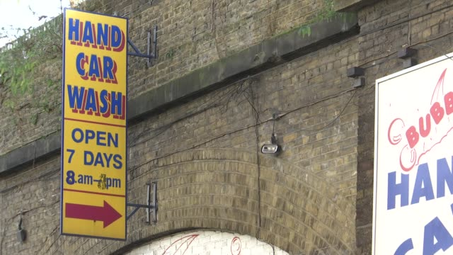 boss convicted of manslaughter after romanian worker killed by faulty electric shower england london bethnal green ext wide shot car wash under... - bubble stock videos & royalty-free footage