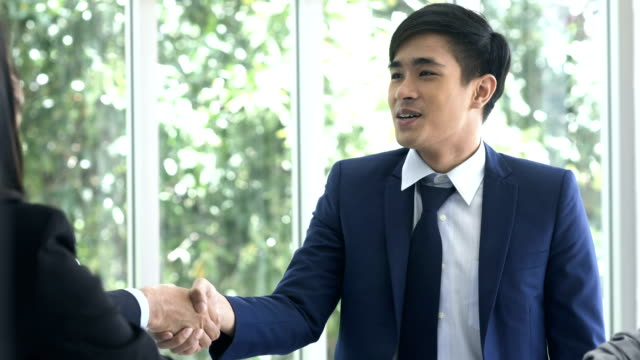 boss handshaking employee satisfied with good work - customer stock videos & royalty-free footage