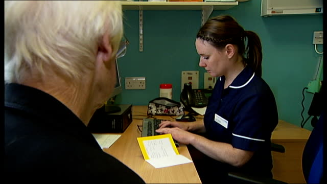 nhs bosses in london warn of future budget shortfall london roehampton queen mary's hospital minor injuries unit various shots of elderly woman... - direttrice video stock e b–roll