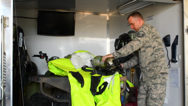 Bossier City, Louisiana Military Varksdale Air Fouce Base All Hazard Response Team AF officier checking equipment for HMR or Hazardous Materials Response