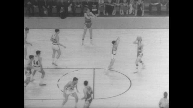 Boston College Eagles play the North Carolina Tar Heels in the NCAA finals / game begins / specific players mentioned are Bob Lewis and Larry Miller...