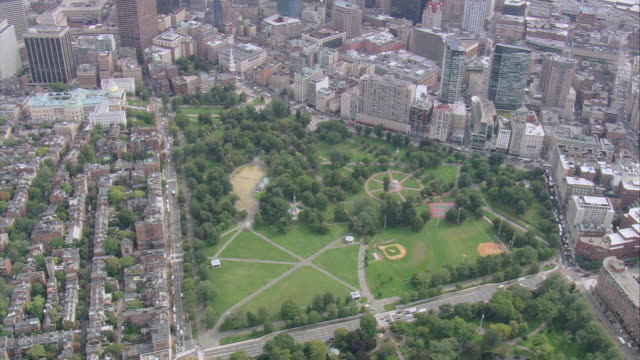 aerial boston common park grounds with grass, trees, and baseball diamond / boston, massachusetts, united states - back bay boston stock videos & royalty-free footage