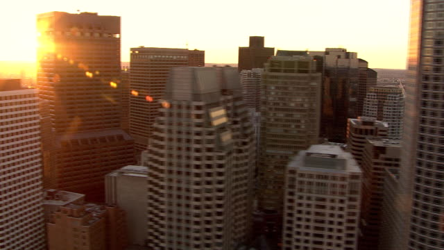 LOW AERIAL, Boston downtown buildings at sunset, Massachusetts, USA